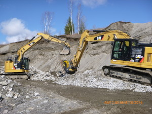 Crushing Bucket Being Loaded by Cat 314E